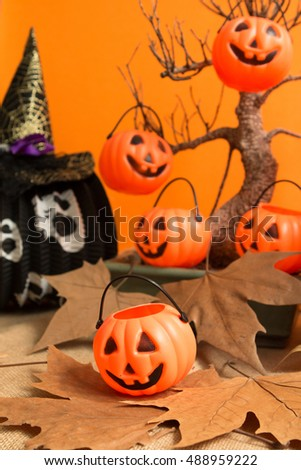 Halloween decoration. Hanging pumpkins on a dry tree
