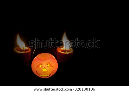 Halloween decoration of orange plastic Jack-O-Lantern isolated on black , abstract background to Halloween toy concept.