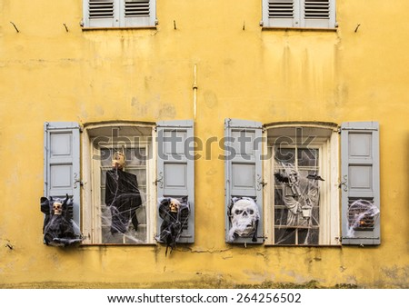 Halloween decorations on the windows of houses - stock photo