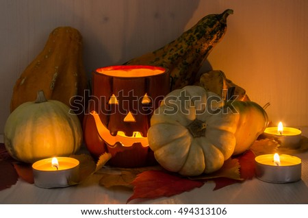 Halloween Decorations with Candles and a Wooden Background