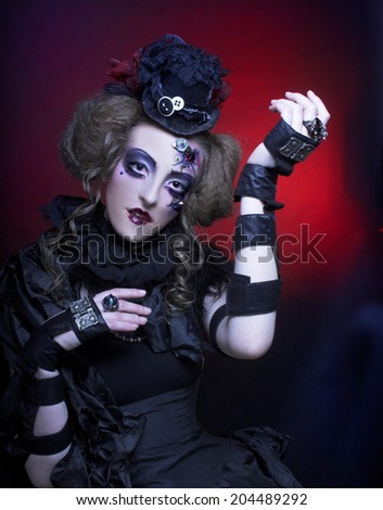 Halloween Doll. Young woman in holiday image of mystery gothic doll. - stock photo