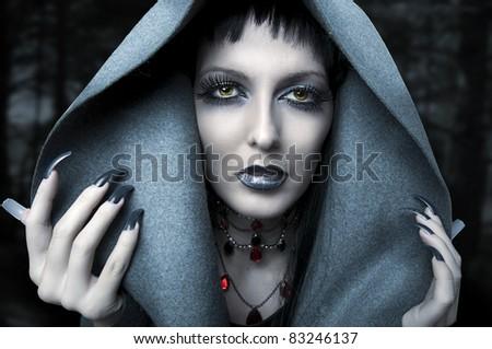 Halloween. Fashion portrait of witch or night vampire woman. Dark gothic makeup - stock photo