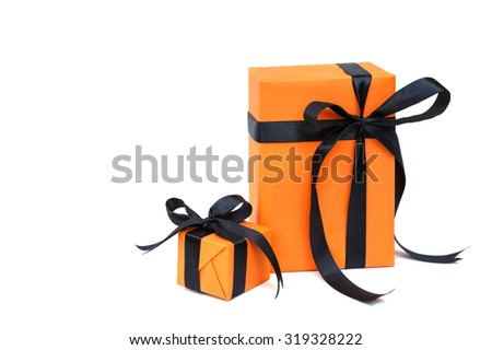 Halloween gift  orange color gift box with black bow isolated on white - stock photo