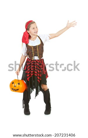 Halloween: Girl Pirate With Pumpkin Bucket Gestures To Side - stock photo