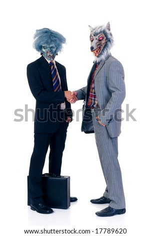 Halloween greedy businessmen wearing Halloween mask.  studio shot, white background - stock photo