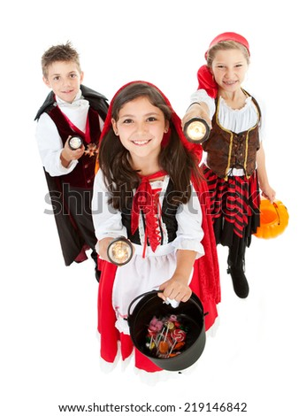 Halloween: Group Of Costumed Kids Out Trick Or Treating - stock photo