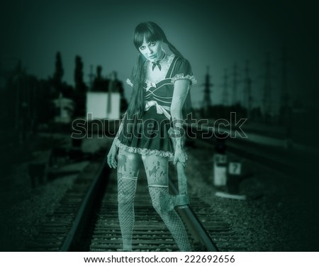Halloween horror. Dirty transparent blured woman holding ax in hand outdoor  - stock photo