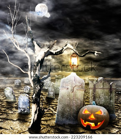 Halloween, Jack o' lantern in the cemetery - stock photo