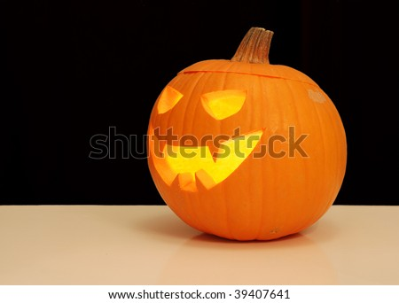Halloween Jack-o'-Lantern, lit from the inside - stock photo
