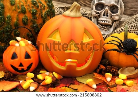 Halloween Jack o Lantern scene with candy and decor - stock photo