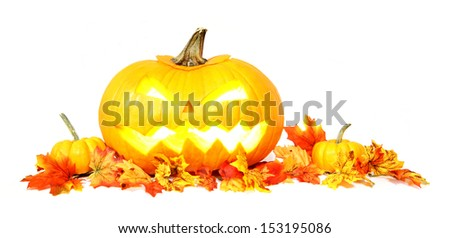 Halloween Jack o Lantern with autumn leaves over white - stock photo