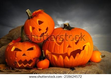 Halloween Jack o Lanterns with dark cloud background - stock photo