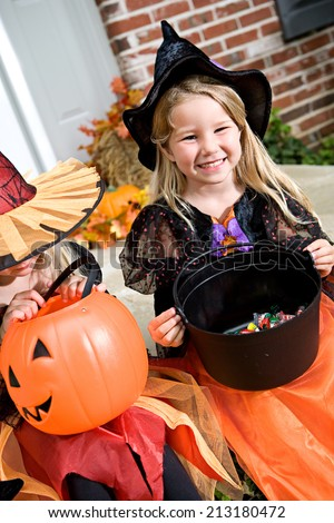 Halloween: Kids Sit On Porch To Look At Candy