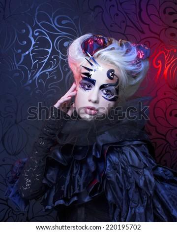 Halloween lady. Young woman in creative magic image. - stock photo