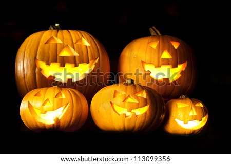 Halloween lantern head pumpkins scary spooky and creepy faces in the dark night - stock photo