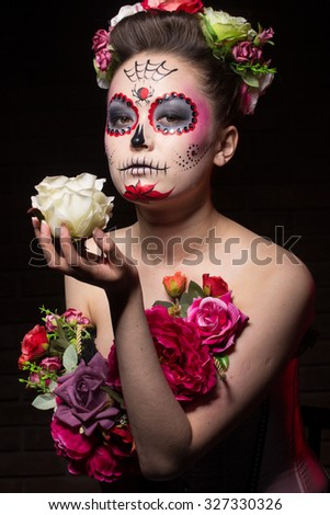 halloween make up sugar skull beautiful model with perfect hairstyle. Santa Muerte concept. motion effect, blur effect - stock photo
