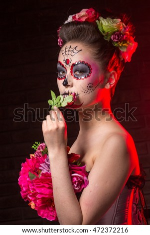 halloween make up sugar skull beautiful model with perfect hairstyle. Santa Muerte concept. motion effect, blur effect