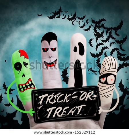 Halloween monsters holding list - stock photo