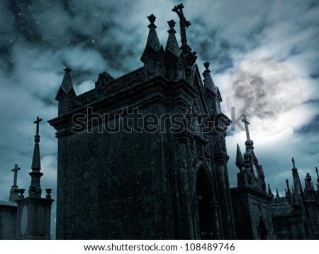 Halloween night scenery with full moon, cloudy sky, stars and old European cemetery - stock photo