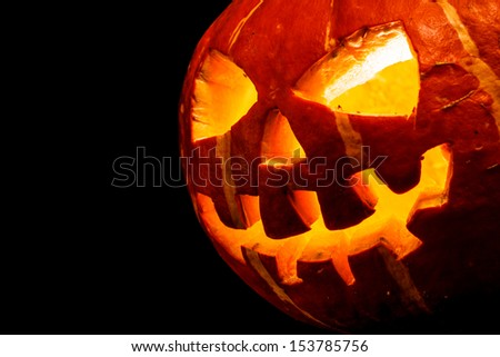 Halloween - old jack-o-lantern on black background - stock photo