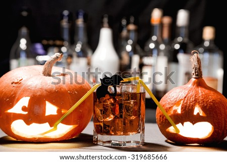 Halloween party. Funny Pumpkin with a cocktail - stock photo
