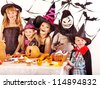 Halloween party with children holding carving pumpkin. - stock photo