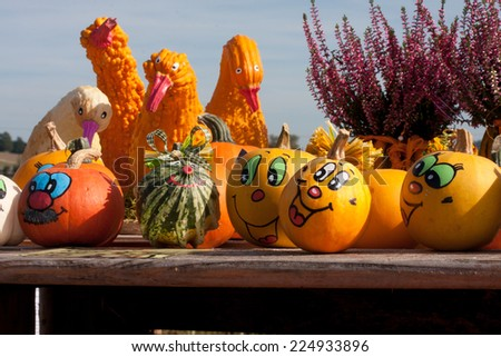 Halloween people made with different types of pumpkins - stock photo