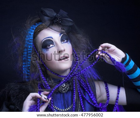 Halloween. Portrait of young woman posing in gothic image.