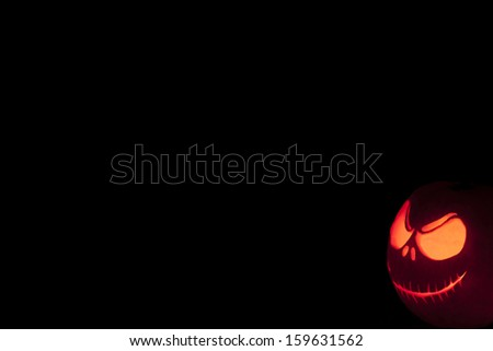 Halloween pumpkin grimming face in the dark close up - stock photo