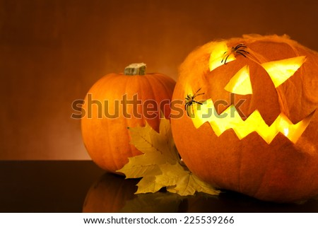 Halloween pumpkin head jack lantern with scary evil faces spook - stock photo