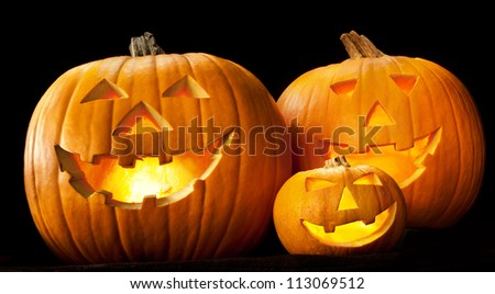 Halloween pumpkin head jack lantern with scary evil faces spooky holiday - stock photo