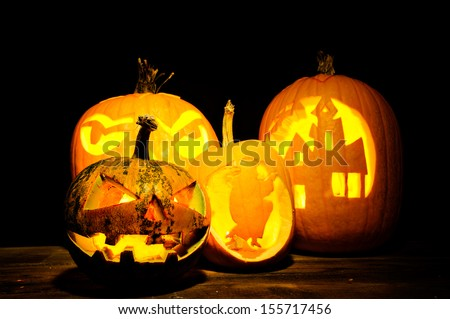 Halloween pumpkin head jack lantern with scary evil faces spooky holiday - stock photo