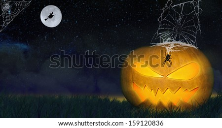 Halloween pumpkin. Horror background with  pumpkins and spider web.  Space for your Halloween holiday text. - stock photo