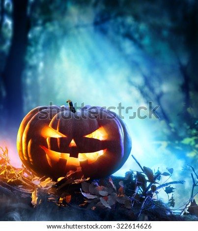 Halloween Pumpkin In A Spooky Forest At Night - Scary Scene  - stock photo