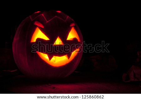 Halloween pumpkin isolated on black background - stock photo