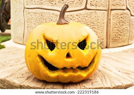 Halloween pumpkin on a well - stock photo