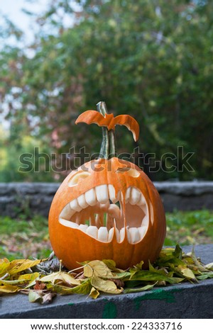 Halloween pumpkin on leaves background - stock photo