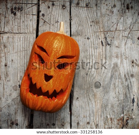 Halloween Pumpkin on wooden background - stock photo