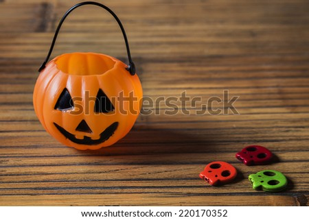 Halloween pumpkin on wooden with ghosts - stock photo