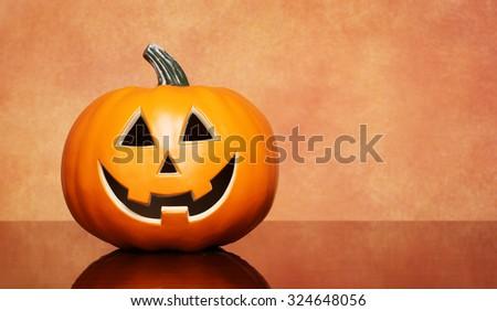 Halloween pumpkin over brown background - stock photo