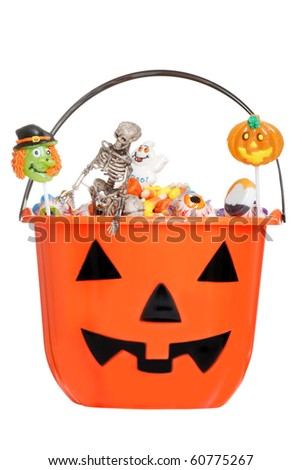 halloween pumpkin pail filled with candy - stock photo