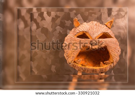 Halloween pumpkin with a light into the shadows, stacked blur background. - stock photo