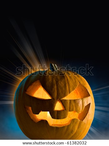 Halloween pumpkin with burning candle inside - stock photo