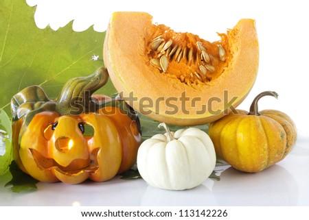 halloween pumpkin with decorative pumpkins - stock photo