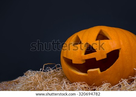 Halloween pumpkin with funny face over grey background - stock photo