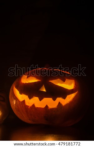 Halloween pumpkin with scary face on black backgound