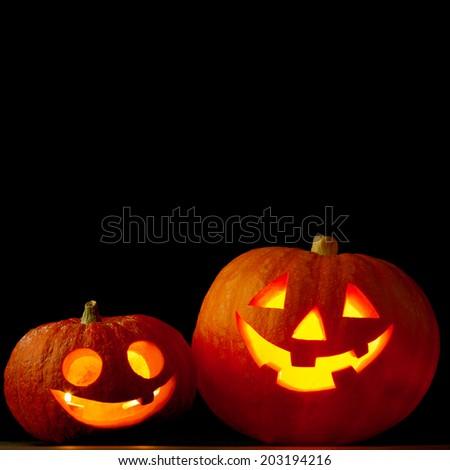 Halloween pumpkins isolated on black background - stock photo