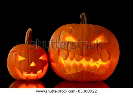 Halloween pumpkins isolated on black background - stock photo