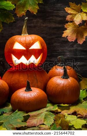 Halloween pumpkins on autumn leaves - stock photo