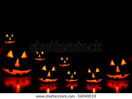 Halloween pumpkins on black - stock photo